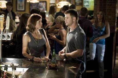 "Adrianne Palicki and Chris Hemsworth in ""Red Dawn."""